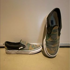 Custom camouflage and black slip on VANS
